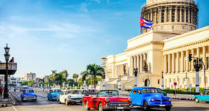 Vintage cars at rush hour in the morning in front of capitolio in La Havana, Cuba